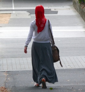 woman walking down street with hijab