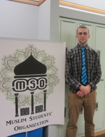 Me standing beside the MSO banner. With an 8-bit tie