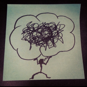 Stick figure holding up a bubble of scrambled thoughts