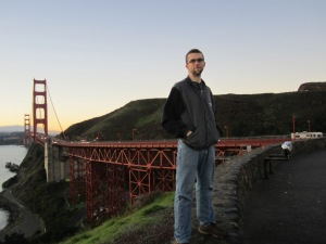 Man standing next to Golden Gate Bridge