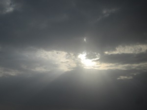 Sun hiding behind the clouds.
