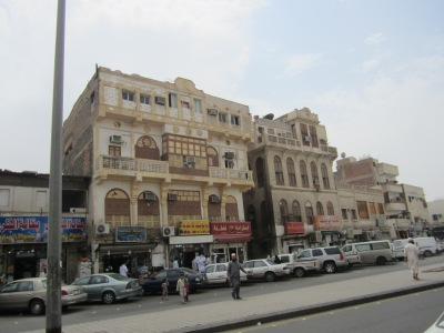 A large shopping building with Arabic signs