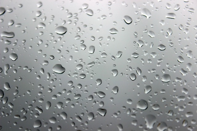 Rain drops against a pane of glass