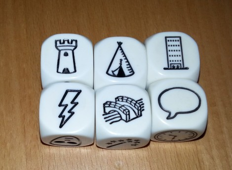 Story Dice: A castle, tent, skyscraper, lightning bolt, bridge and speech bubble.