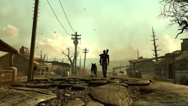 A man walking down a post-apocalyptic street with a dog.